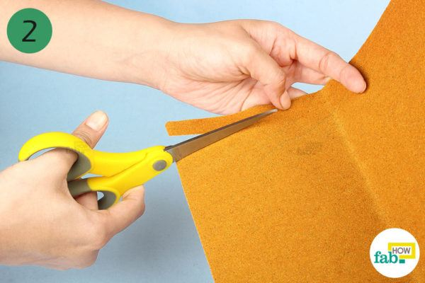 Cut long strips of sandpaper with the scissors