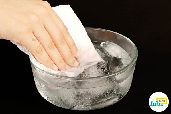 dip a cotton cloth in ice cold water