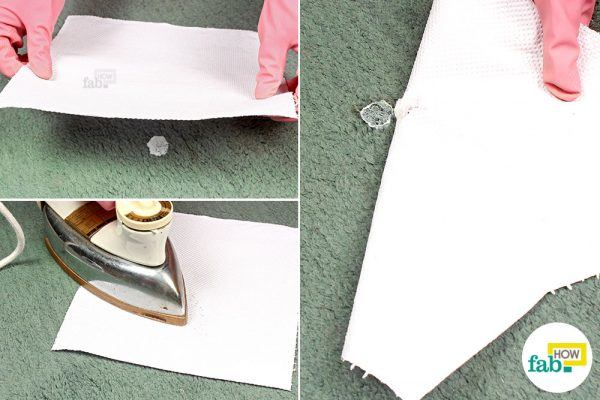 melt-the-hardened-glue-with-a-hot-iron-and-absorb-it-onto-paper-towels