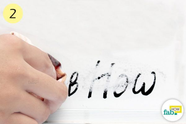 buff the dry erase board with baking soda