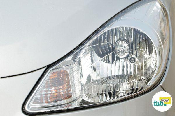 clean foggy and dirty car headlight