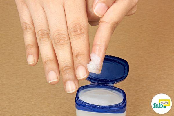 apply petroleum jelly on your hang nails