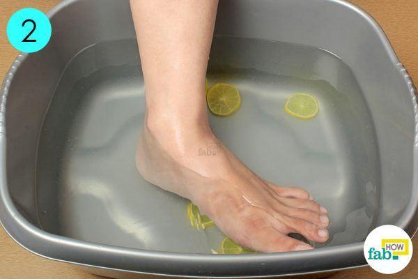 soak your feet in lemon water for cracked heels