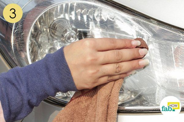 rub the headlight with liquid soap to clean it