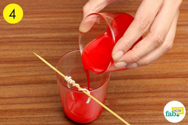 pour the homemade wax into glass cup