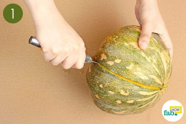 halve the pumpkin to extract seeds