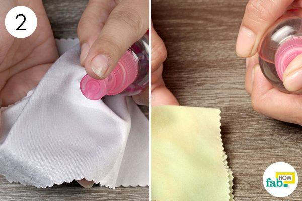 spray some rubbing alcohol on a microfiber cloth for cleaning your device
