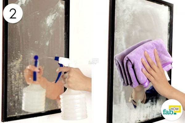 spray diluted vinegar on mirror and wipe with microfiber towel