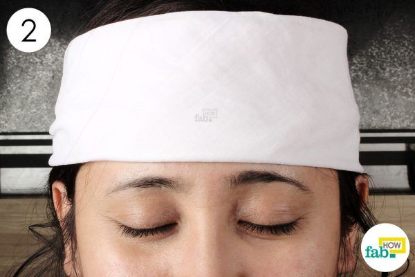 apply cold compress on forehead to reduce fever