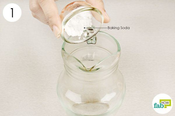 put baking soda in a pitcher for cleaning bathroom