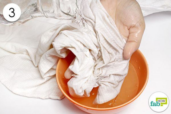 rinse the cloth with water to remove stain