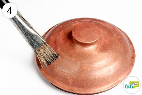 coat the copperware with natural polish
