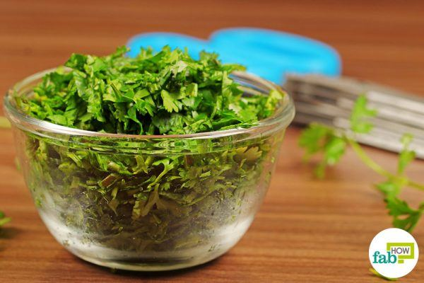 using herb scissors to chop cilantro