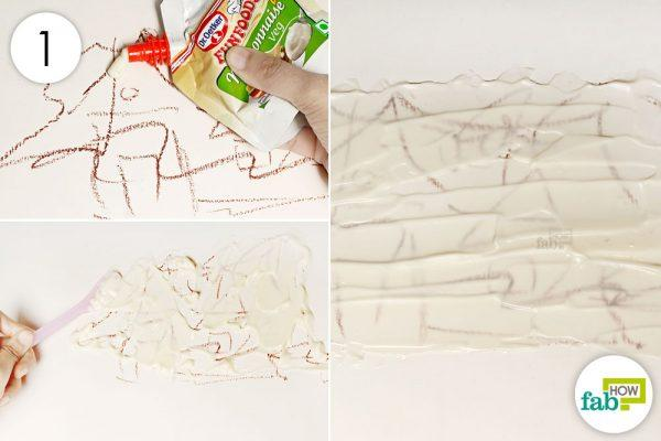 cover the crayon marks with mayonnaise