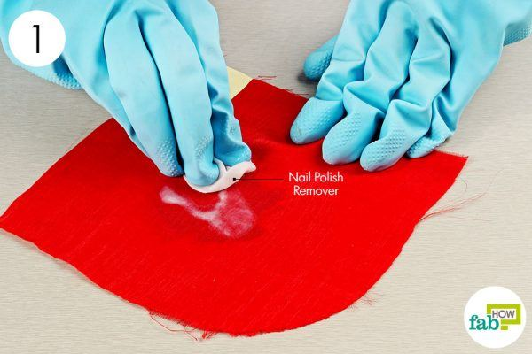dab the nail polish stain with non-acetone nail polish remover