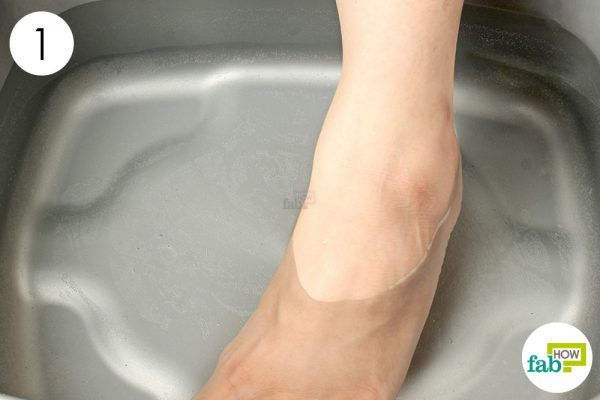 soak affected foot in hot water to get rid of corn