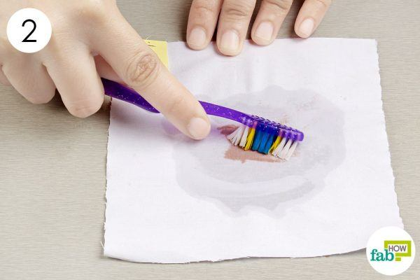 scrub the nail polish stain with an old toothbrush