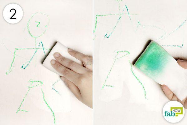 rub the magic eraser over the crayon markings