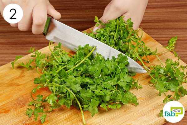 scrape cilantro leaves with knife