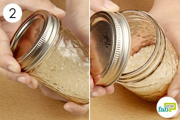 twist and open the stuck lid of the jar