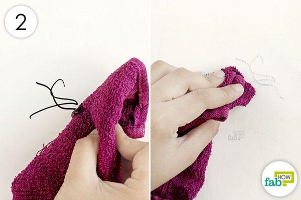 wipe the wall with towel soaked in hand sanitizer to remove permanent ink