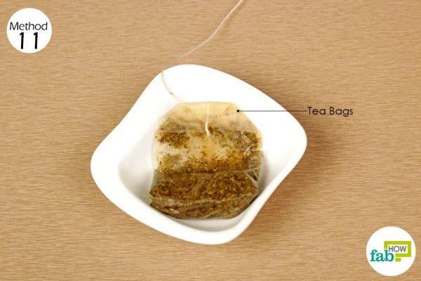 apply used tea bag on the sore