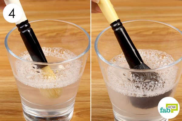 swril makeup brushes into soapy water