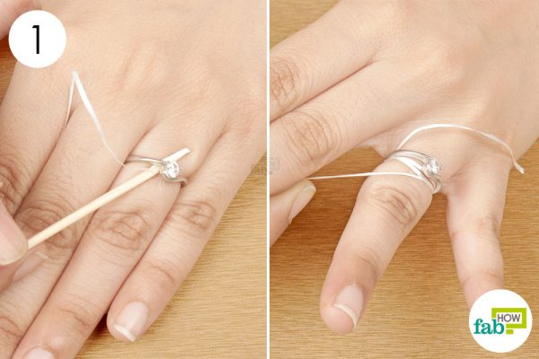 slide the floss under the ring