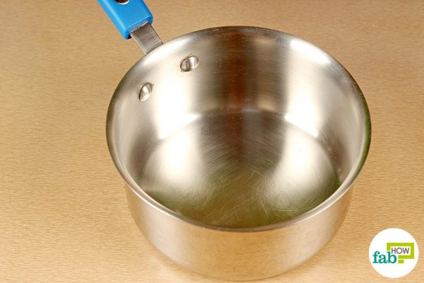 final cleaning stainless steel pan with windex