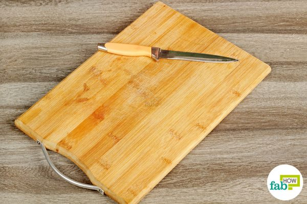 final cleaning wooden cutting board and knife