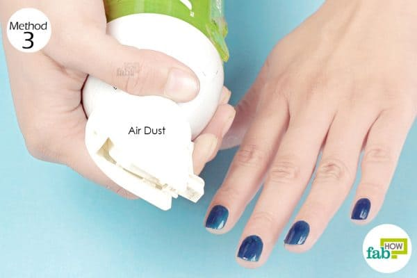 spray air dust on your nails