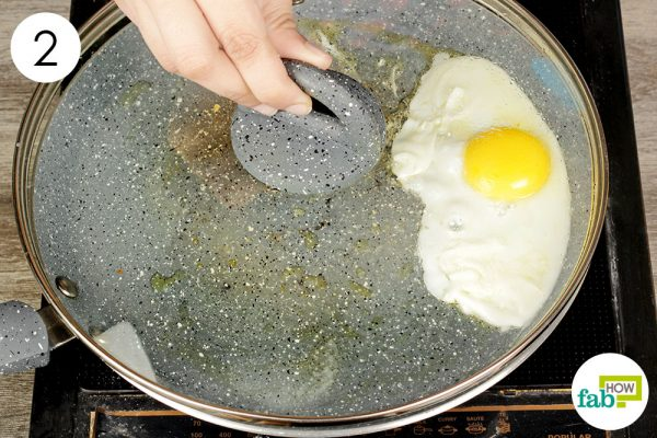 cover with the lid to cook the egg