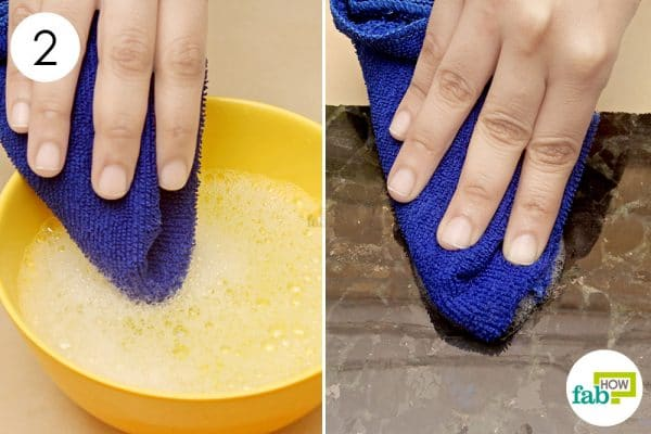scrub the granite with the soap solution
