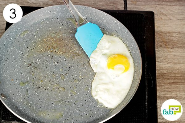 transfer the cooked egg to a plate