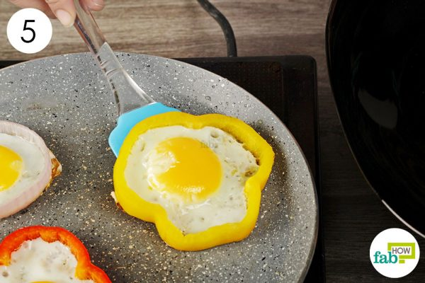 transfer the cooked eggs to a plate