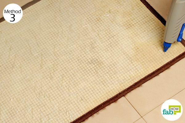 apply glue on the underside of doormat