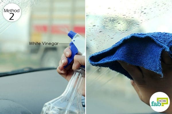 wipe the glass surface of car with diluted vinegar