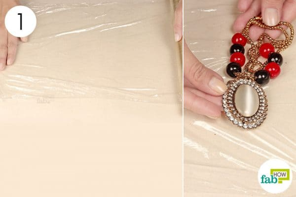 spread plastic wrap and place jewelry