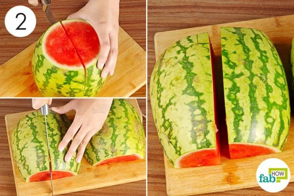 cut watermelon into halves and quarters