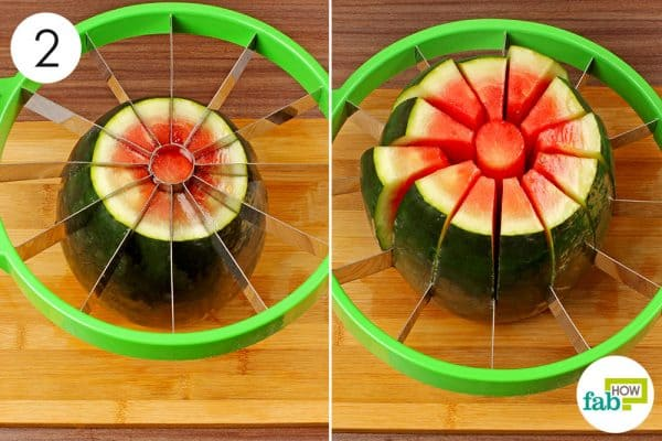 push the slicer down on the watermelon