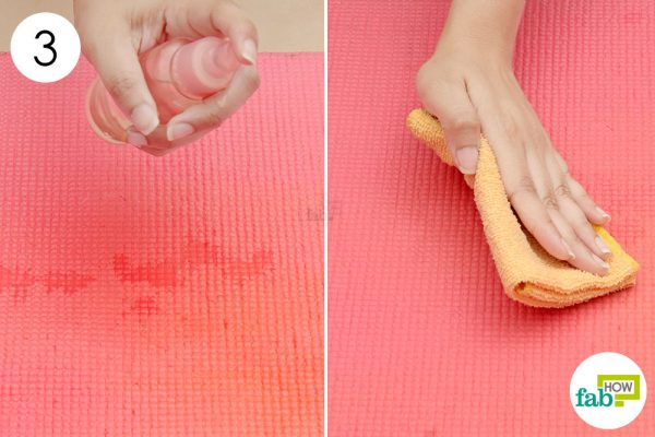 spray it on mat and wipe with towel