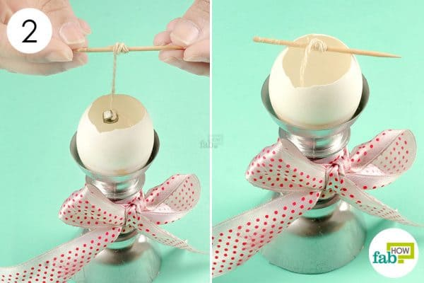 Fix the candle wick inside the cleaned eggshell