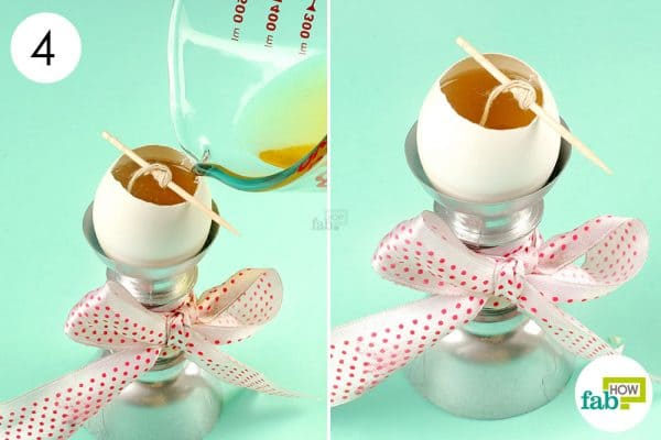 Pour the melted wax into the eggshell and let it cool down