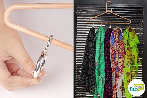 Stick curtain rings on the hanger to hold your scarves