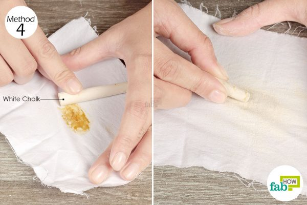 Use a piece of white chalk to soak up all the grease from the gravy stain