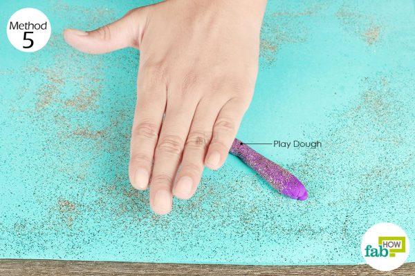 Clean up glitter using playdough