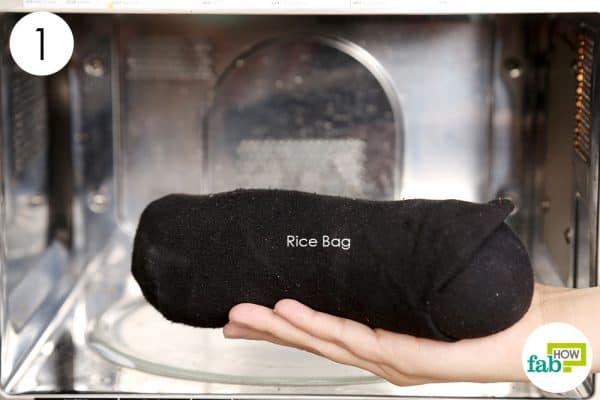 Prepare a rice compress and heat it up to get rid of foot pain