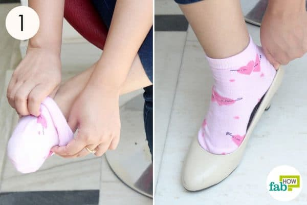 Put on a pair of thick socks to treat shoe bite