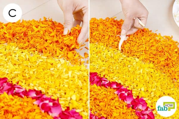 Add more layers of light and dark marigold petals; use tuberose flowers in the outermost layer