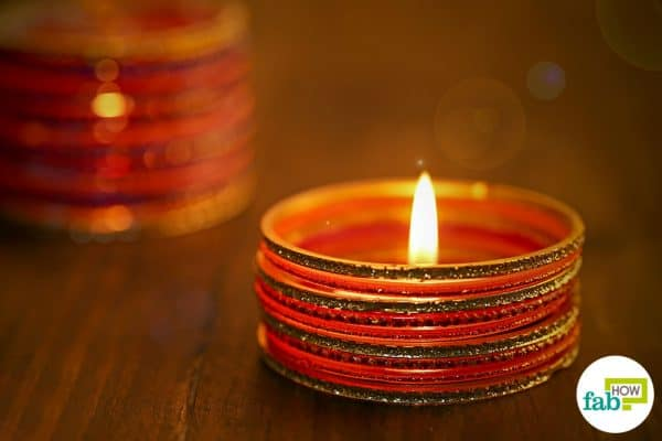 Pile up 8 to 10 bangles and place a tealight in the center to make beautiful diyas for Diwali